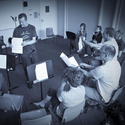 Harmonica Teacher Steve Lockwood addresses his class